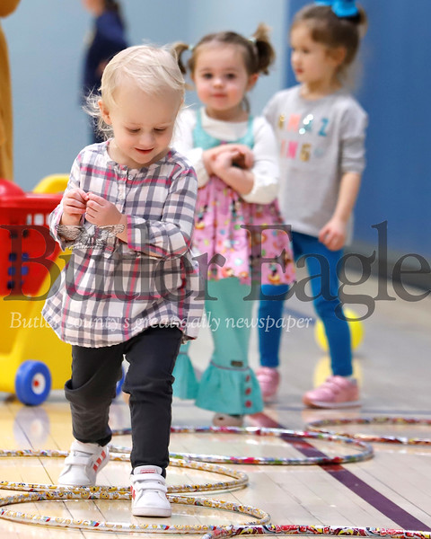 Madi Ori, 2, of Cranberry takes a step on the hop scotch course set up in the Cranberry Township Municipal Center Gym Thursday during the township's Playtime Pals program. The program for kids age 5 and under and their parents takes place every Tuesdays and Thursdays, activities include open gym time, games and craft projects. Seb Foltz/Butler Eagle