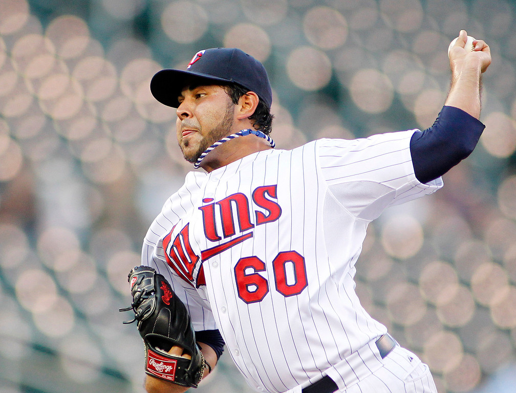 . Minnesota Twins starting pitcher Pedro Hernandez  throws to the Los Angeles Angels in the first inning of their baseball game in Minneapolis Monday, Sept. 9, 2013.(AP Photo/Andy Clayton-King)