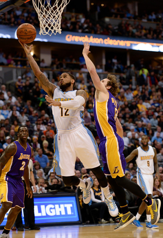 . DENVER, CO - MARCH 2: Denver Nuggets guard D.J. Augustin (12) flies past Los Angeles Lakers guard Marcelo Huertas (9) for an easy layup March 2, 2016 at Pepsi Center. (Photo By John Leyba/The Denver Post)