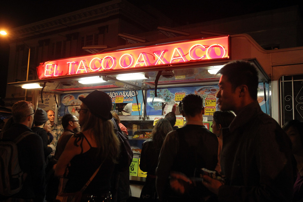 . People wait in line to order Mexican food from aTaco Truck during the First Friday/Art Murmur on Telegraph Avenue in Oakland, Calif., on Friday, March 1, 2013. Police presence was noticeable since it marked a month when 18-year-old Kiante Campbell was shot and killed after the event in the parking lot of a beauty supply business in the 2000 block of Telegraph Avenue.  (Ray Chavez/Staff)