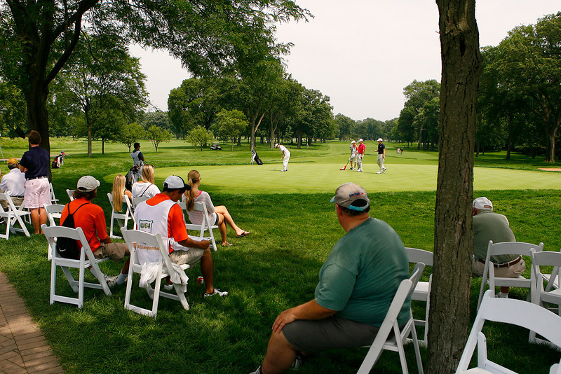 Fans watch the putting action on 18 during the first round Tuesday.