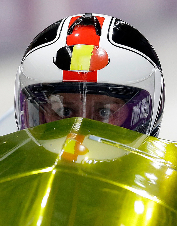 . The team from Belgium BEL-1, piloted by Elfje Willemsen with brakeman Hanna Emilie Marien, start their first run during the women\'s two-man bobsled competition at the 2014 Winter Olympics, Tuesday, Feb. 18, 2014, in Krasnaya Polyana, Russia. (AP Photo/Natacha Pisarenko)