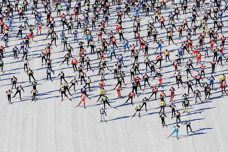. Cross-country skiers start during the Engadin Ski Marathon on the frozen Lake Sils near the village of Maloja on March 10, 2013. More than 12,000 skiers participated in the 26.2 mile race between Maloja and S-chanf near the Swiss mountain resort of St. Moritz. REUTERS/Michael Buholzer