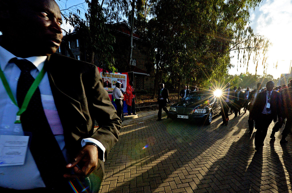 . Kenyan Presidential security escort newly elected President Uhuru Kenyatta\'s car after he gave a speech following his victory in Kenya\'s national elections in Nairobi on March 9, 2013. AFP PHOTO/ Carl  DE SOUZA/AFP/Getty Images