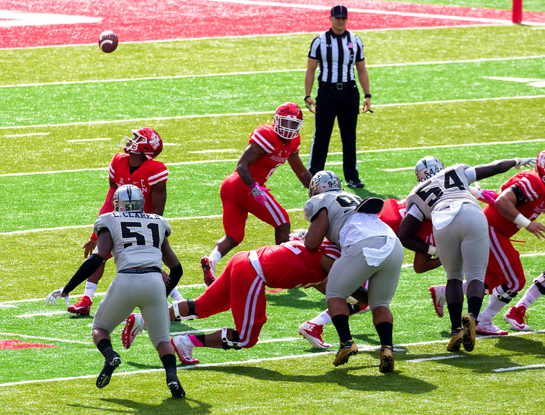 First UH play: High snap.  Ward bobbles the ball, recovers his fumble for a loss of 8 yards.