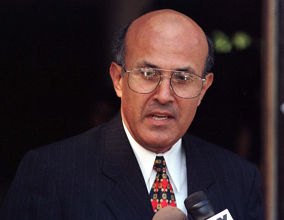 . Chief Lee Baca talks with reporters after casting his ballot Tuesday, Nov. 3, 1998 in Pasadena, Calif. Baca is trying to defeat Los Angeles County Sheriff Sherman Block who died last week from a bloodclot in his brain but remains on the ballot. (AP Photo/Kevin Karzin)