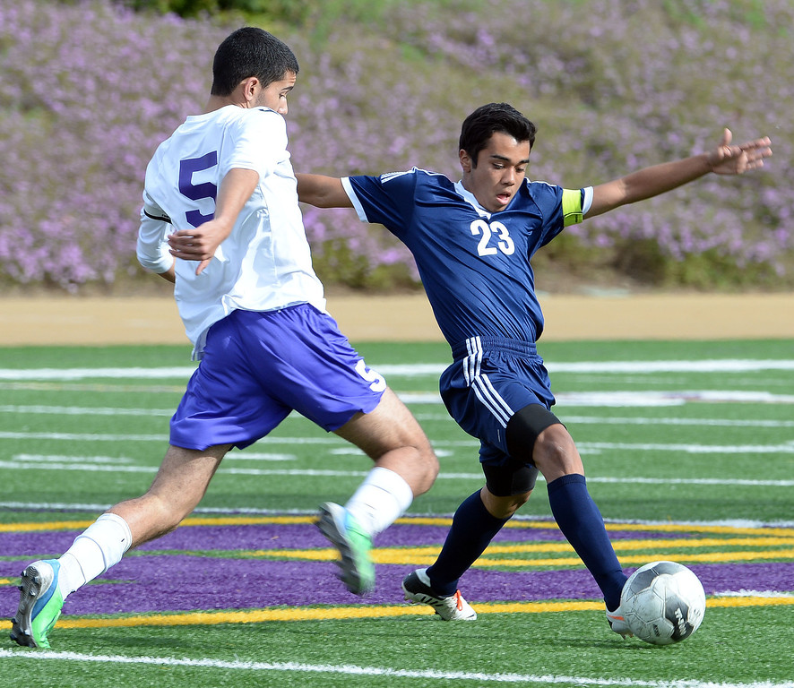 . Baldwin Park\'s Javier Jasso (23) controls the ball past Diamond Bar\'s Spenser Brose (C) (5) in the first half of a CIF-SS quarterfinal prep playoff soccer match at Diamond Bar High School in Diamond Bar, Calif., on Thursday, Feb.27, 2014. Baldwin Park won 2-1. (Keith Birmingham Pasadena Star-News)
