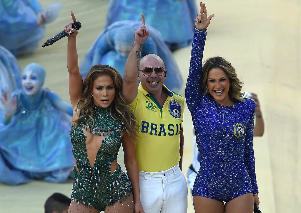 . U.S. rapper Pitbull (C) Brazilian pop singer Claudia Leitte (R) and US singer Jennifer Lopez (L) salute the audience as they take part in the opening ceremony of the 2014 FIFA World Cup at the Corinthians Arena in Sao Paulo on June 12, 2014, prior to the opening Group A football match between Brazil and Croatia.     AFP PHOTO / PEDRO  UGARTE/AFP/Getty Images