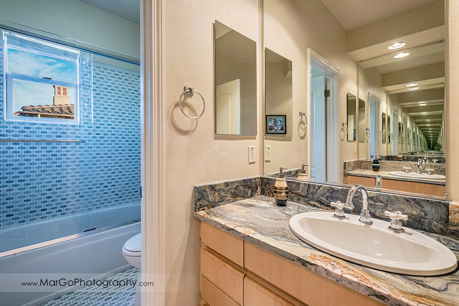 blue and yellow bathroom with mirrors in San Ramon house - real estate photography