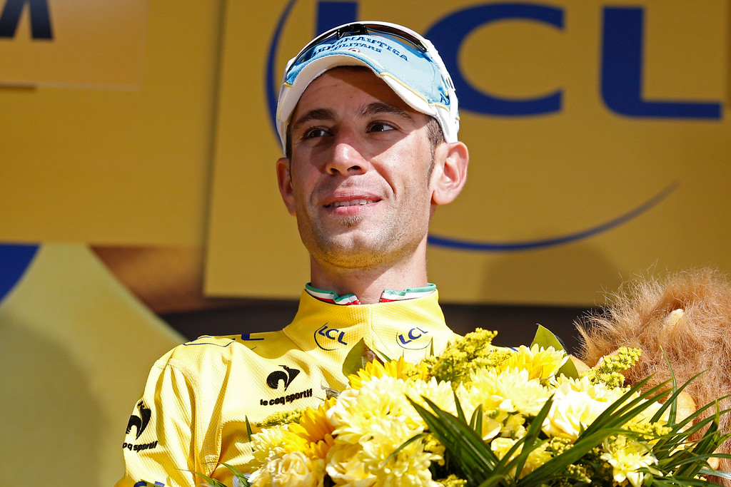 . Italy\'s Vincenzo Nibali, wearing the overall leader\'s yellow jersey, celebrates on the podium of the twentieth stage of the Tour de France cycling race, an individual time-trial over 54 kilometers (33.6 miles) with start in Bergerac and finish in Perigueux, France, Saturday, July 26, 2014. (AP Photo/Christophe Ena)