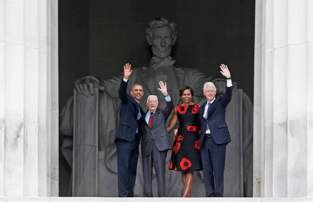 . President Barack Obama, first lady Michelle Obama, former President Jimmy Carter and former President Bill Clinton wave as they leave 50th Anniversary of the March on Washington where Martin Luther King Jr., spoke, Wednesday, Aug. 28, 2013, at  the Lincoln Memorial in Washington. (AP Photo/Charles Dharapak)