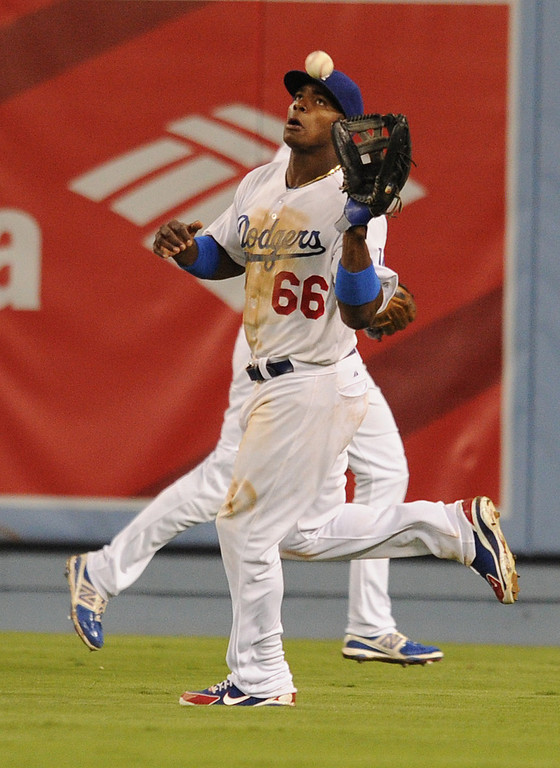 . Dodgers Yasiel Puig hauls in a Didi Gregorius fly to center field in the 10th inning. The Dodgers defeated the Arizona Diamondbacks 5-3 after Scott Van Slyke hit a 2 run walk off homer in the 11 inning at Dodger Stadium in Los Angeles, CA. 9/10/2013. photo by (John McCoy/Los Angeles Daily News)