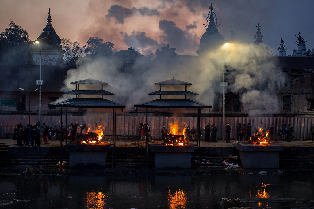 . Victims of the earthquake are cremated at Pashupatinah Temple on April 29, 2015 in Kathmandu, Nepal. A major 7.8 earthquake hit Kathmandu mid-day on Saturday, and was followed by multiple aftershocks that triggered avalanches on Mt. Everest that buried mountain climbers in their base camps. Many houses, buildings and temples in the capital were destroyed during the earthquake, leaving over 4600 dead and many more trapped under the debris as emergency rescue workers attempt to clear debris and find survivors. Regular aftershocks have hampered recovery missions as locals, officials and aid workers attempt to recover bodies from the rubble.  (Photo by Chris McGrath/Getty Images)