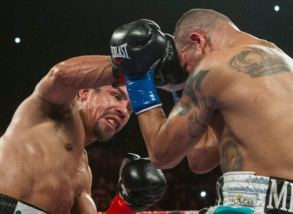 . Mike Alvarado, right, and Juan Manuel Márquez, of Mexico, exchange punches in the tenth round of a WBO welterweight title boxing match at the Forum in Inglewood, Calif., Saturday, May 17, 2014. Márquez won the title.  (AP Photo/Ringo H.W. Chiu)