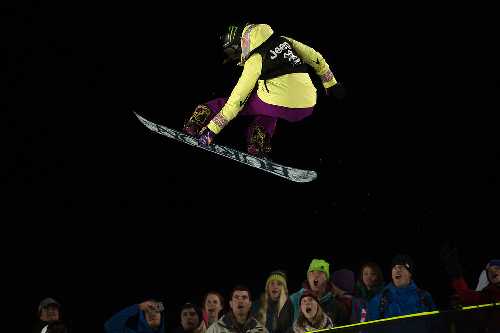 . Chloe Kim grabs her snowboard during the final run of the women\'s snowboard superpipe final at Winter X Games Aspen 2015 at Buttermilk Mountain on January 24, 2015, in Aspen, Colorado. Kim, 14, is the youngest gold medalist in X Games history. (Photo by Daniel Petty/The Denver Post)