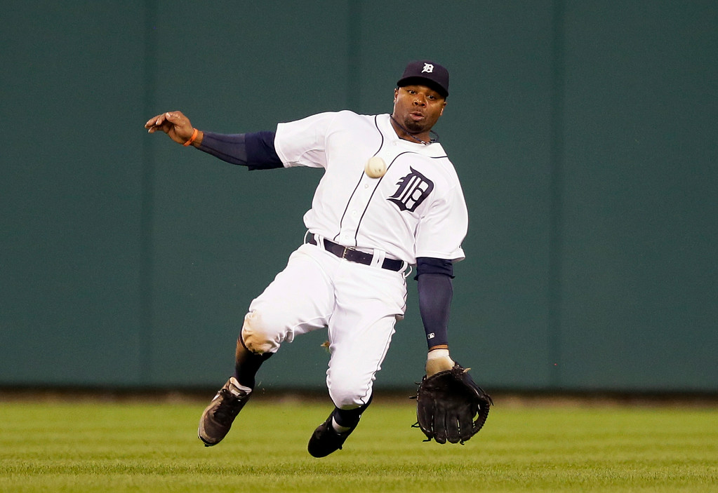 . Detroit Tigers center fielder Rajai Davis dives but misplays the single by Seattle Mariners\' Robinson Cano during the fifth inning of a baseball game, Friday, Aug. 15, 2014, in Detroit. (AP Photo/Carlos Osorio)