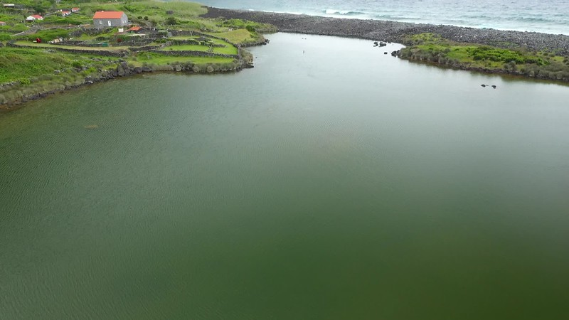 Available in 4K - Aerial video clip showing the lake of Fajã dos Cubres in a molly in move, The Azores