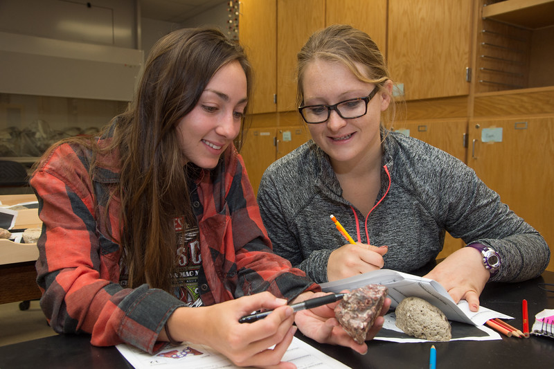 Students Kelby Broussard(left) and Chasidy Palmer classify carbonate rock in geometry lab.