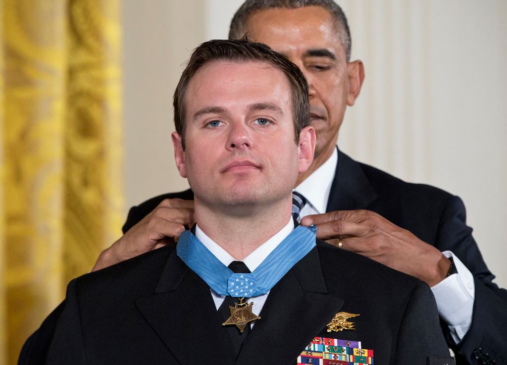. President Barack Obama presents the Medal of Honor to Senior Chief Special Warfare Operator Edward Byers during a ceremony in the East Room of the White House in Washington, Monday, February 29, 2016. Navy Senior Chief Byers is received the Medal of Honor for his courageous actions while serving as part of a team that rescued an American civilian being held hostage in Afghanistan on December 8-9, 2012. (AP Photo/J. Scott Applewhite)