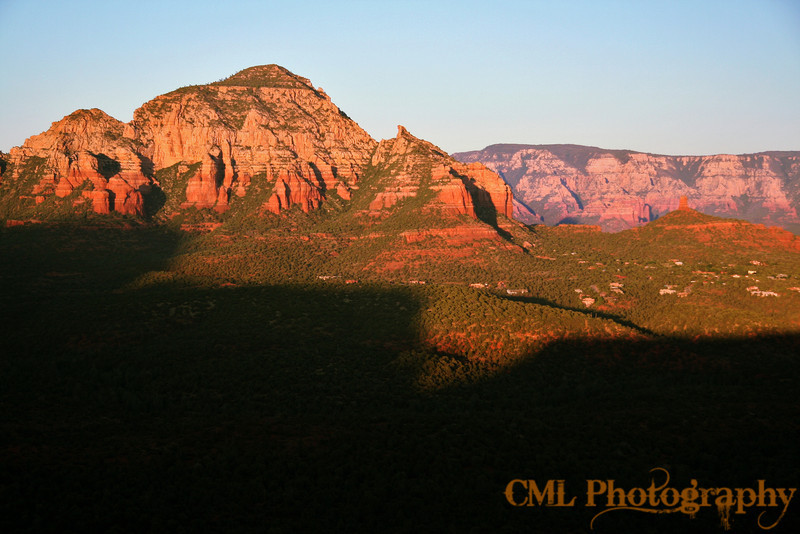 View from the northern rim of Doe Mountain.  You are seeing some of the homes in Sedona on the right and the shadow of the mountain on the bottom.