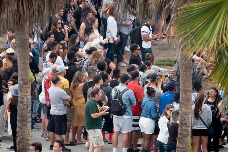 A crowd gathers for one of the man street shows in Venice.