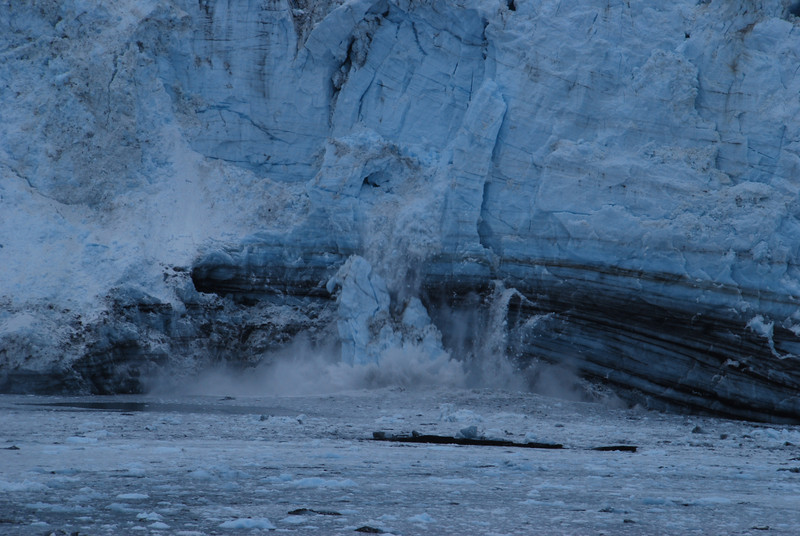 The large chuck of falling ice is about the size of a bus.