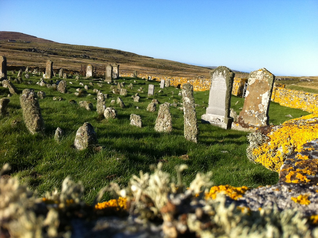 . This October 2013 photo shows an old cemetery on the island of Berneray in the Outer Hebrides, Scotland. Some plots appear to be marked by chunks of rock instead of carved headstones. A hiking trail passes alongside the cemetery. (AP Photo/Cara Anna)