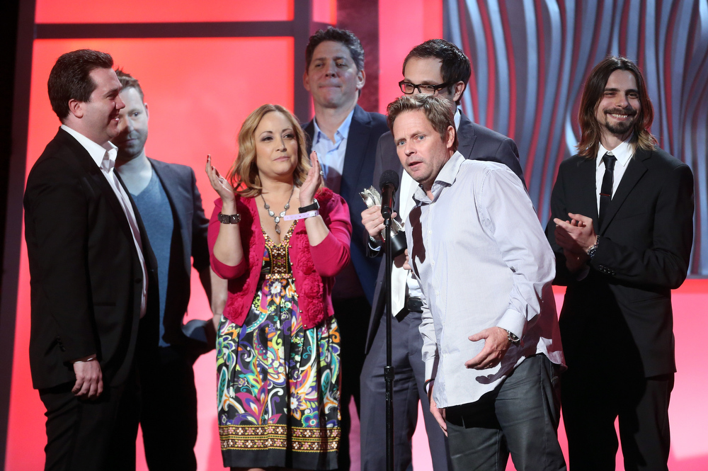 ". Cast and Crew of ""H+ The Digital Series\"" accept the Best Action or Sci-Fi Series award onstage at the 3rd Annual Streamy Awards at Hollywood Palladium on February 17, 2013 in Hollywood, California.  (Photo by Frederick M. Brown/Getty Images)"