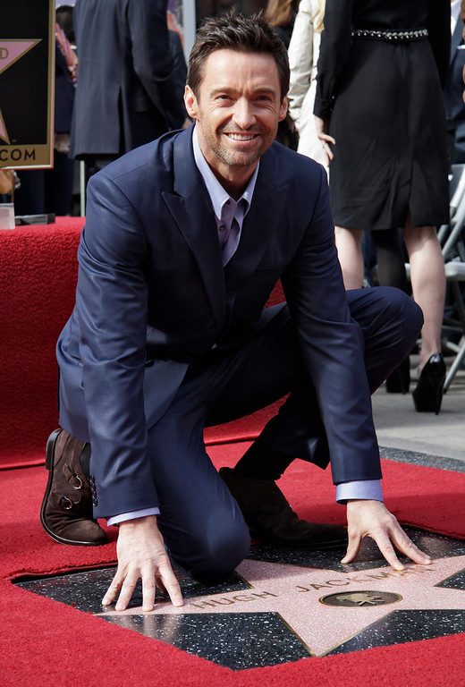 . Actor Hugh Jackman smiles during ceremonies honoring him with a star on the Hollywood Walk of Fame in Hollywood, California, December 13, 2012. REUTERS/Jonathan Alcorn