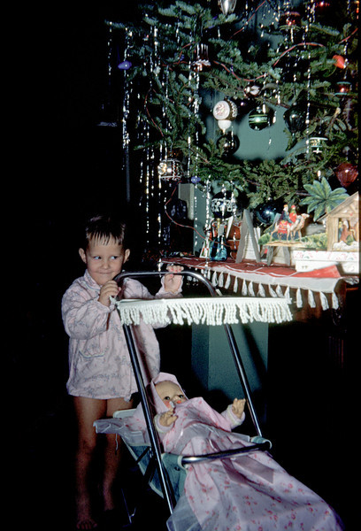 susan with doll carriage at christmas tree.jpg