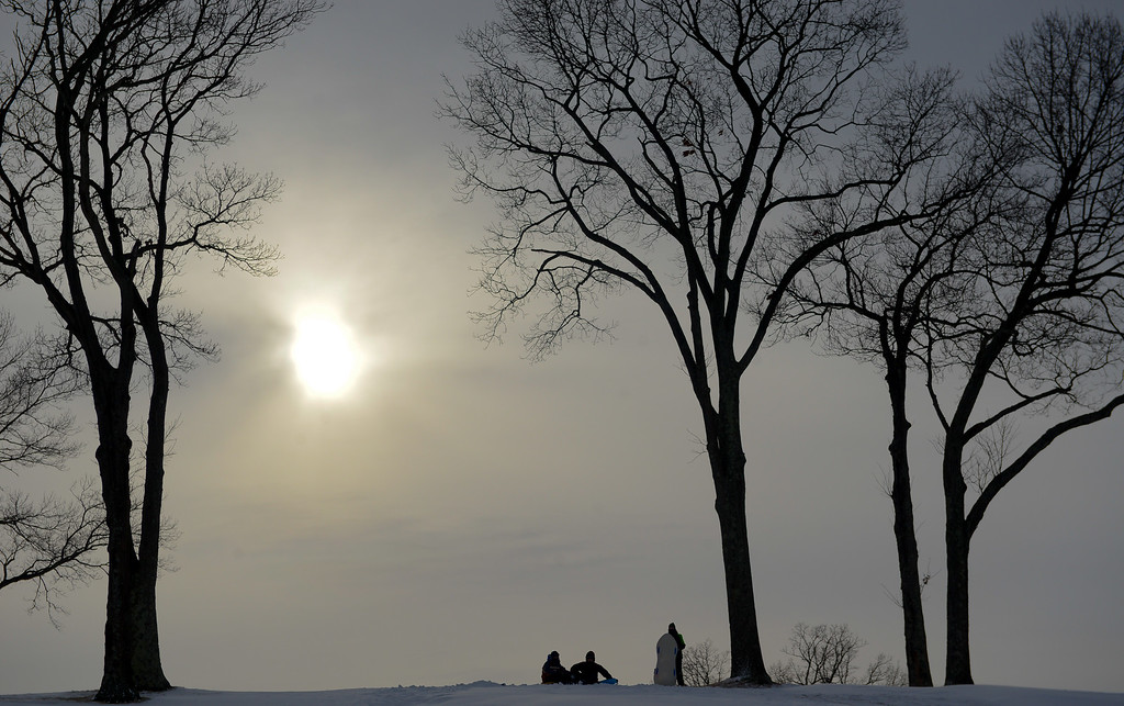 . People enjoy sledding at St. John\'s Golf Course in heavy snow on January 27, 2015 in Setauket, New York. Snow levels from winter storm Juno in New York have ranged from 7.8 inches in Central Park to more than 28 inches in Eastern Long Island.  (Photo by Andrew Theodorakis/Getty Images)