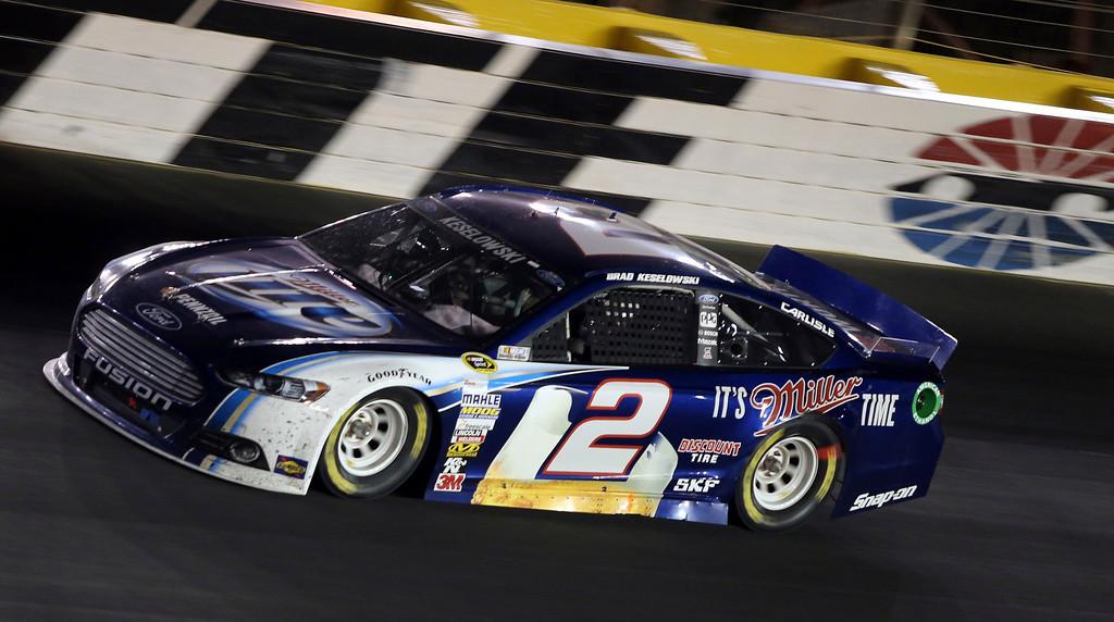 . Brad Keselowski drives through Turn 2 during the NASCAR Sprint Cup Series auto race at Charlotte Motor Speedway in Concord, N.C., Saturday, Oct. 12, 2013. Keselowki won the race. (AP Photo/Bob Jordan)