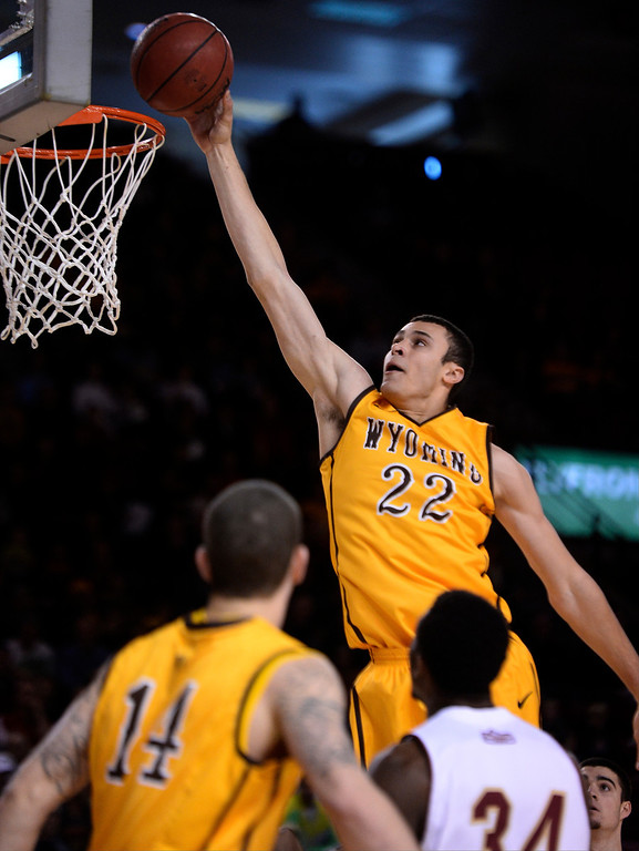 . Wyoming Cowboys forward Larry Nance Jr. (22) goes up for an easy basket during the first half agains the Denver Pioneers  December 15, 2013 Magness Arena. (Photo by John Leyba/The Denver Post)