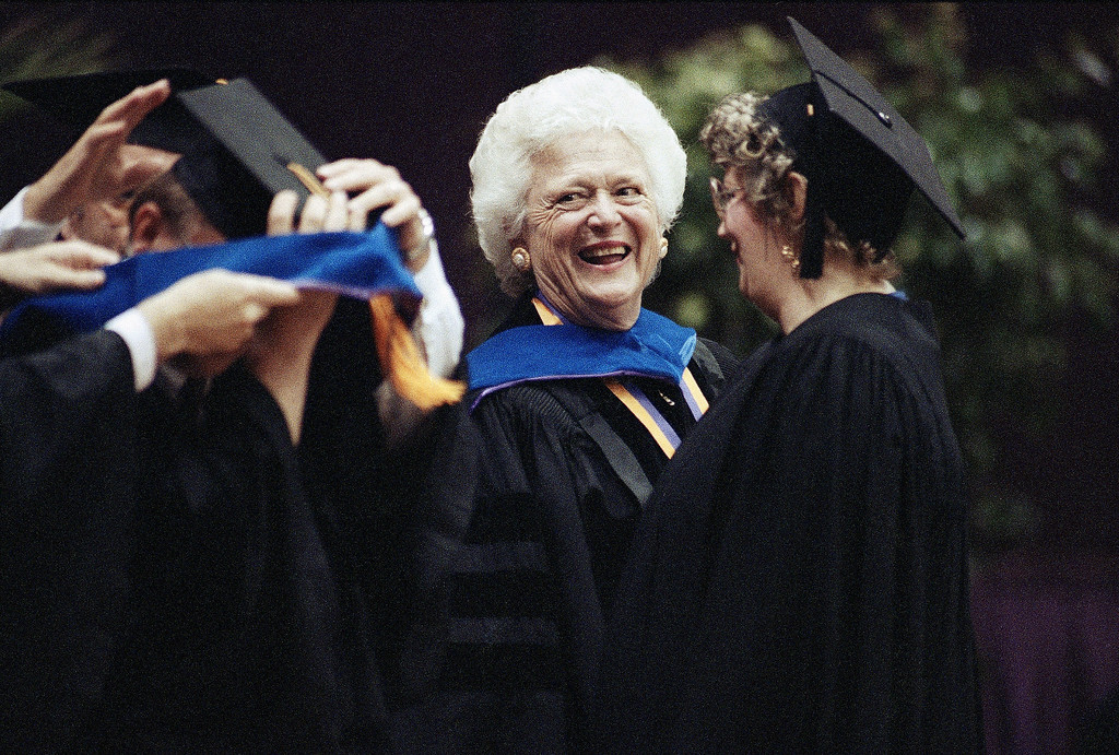 . First lady Barbara Bush, center, laughs and chats with Louisiana State University students as they receive their doctorate degrees, Thursday, May 21, 1992, Baton Rouge, La. Bush was given an honorary degree of Doctor of Humane Letter\'s and spoke to the graduates at the spring commencement ceremonies. (AP Photo/Bill Haber)