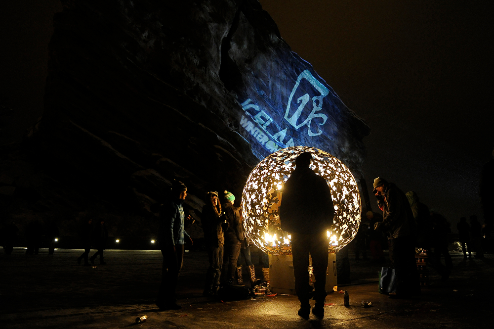 . Fans warm themselves around a fire during Winter on the Rocks at Red Rocks Amphitheatre on January 31, 2014 in Morrison, Colorado. (Photo by Seth McConnell/The Denver Post)