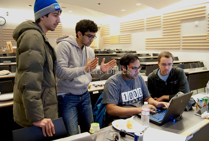 University of Michigan students from left, Danyaal Rangwala, Rahul Raina, Pratik Kabra, and Kyle Summers work on their collaborative DJ app during a 22-hour 'Hackathon' on the University of Michigan's North Campus on Jan 19, 2013.  Their team took first place.  The University of Michigan chapter of Eta Kappa Nu hosted the event and Silicon Valley startup imo.im sponsored it. http://blog.imo.im/2013/01/imo-spends-weekend-in-michigan-for.html