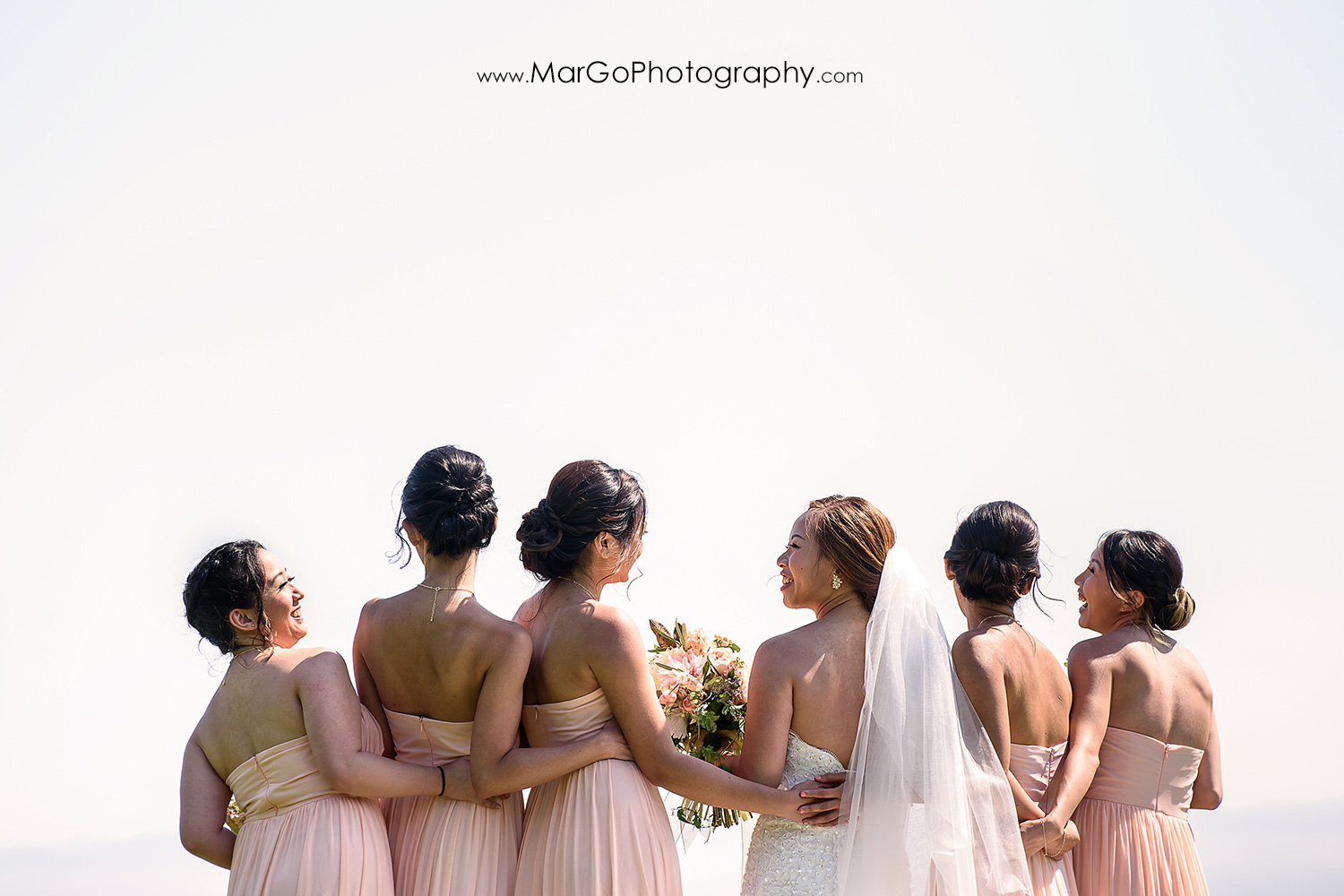 bride with bridesmaids at the University of California, Santa Cruz