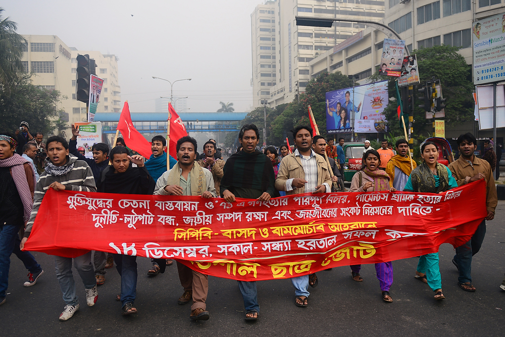. Communist Party of Bangladesh activists and leftist party supporters march during a nationwide strike in Dhaka on December 18, 2012. The daylong strike was called by the Communist Party of Bangladesh and Bangladesher Shamajtantrik Dal, demanding a ban on \'all communal political parties\' including Jamaat-e-Islami. MUNIR UZ ZAMAN/AFP/Getty Images