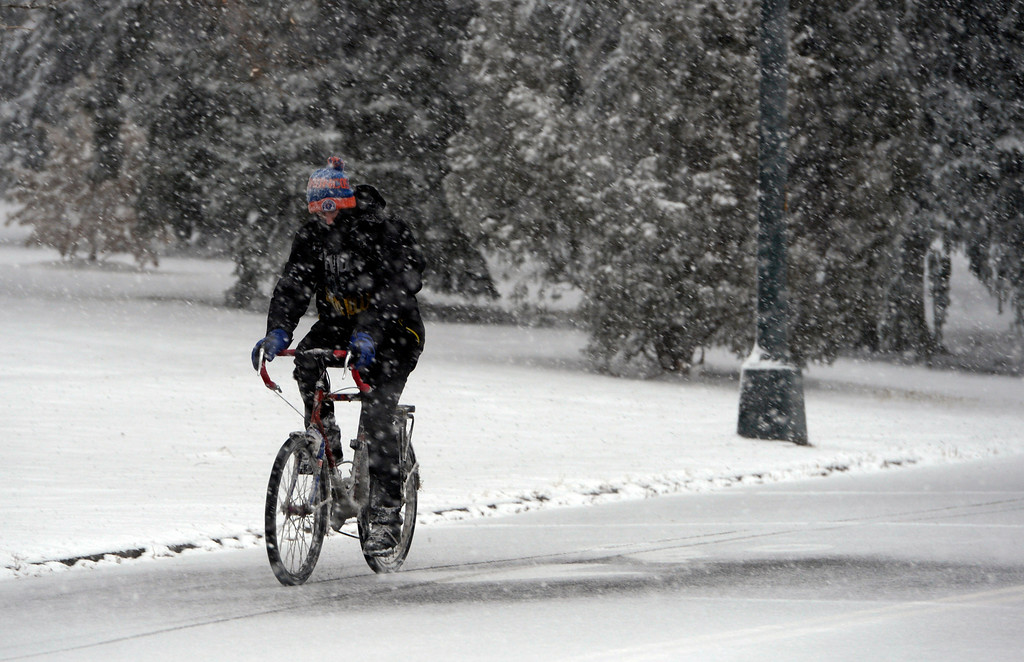 . BOULDER, CO- FEBRUARY 19:   A cyclist makes his way around Wash Park as the snow falls on February 20, 2013..  Snow hit the Denver metro area around 2:30 with forecasters calling for  2-4 inches in Denver more to the South and East.  (Photo By Helen H. Richardson/ The Denver Post)