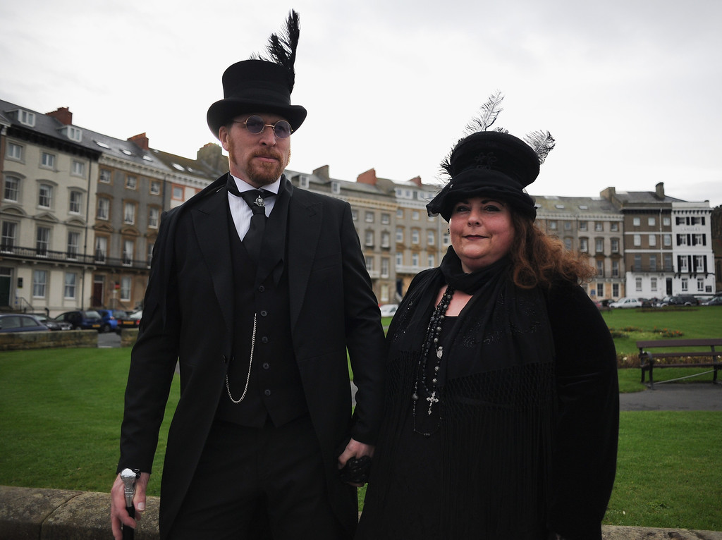 . WHITBY, ENGLAND - NOVEMBER 02: Sarah and Malcolm Simpson from York dress in Victorian style as they visit the Goth weekend on November 2, 2013 in Whitby, England. The Whitby Gothic Weekend that takes place in the Yorkshire seaside town twice yearly in Spring and Autumn started in 1994 and sees thousands of extravagantly dressed followers of Victoriana, Steampunk, Cybergoth and Romanticism visit to take part in celebrating Gothic culture.  (Photo by Ian Forsyth/Getty Images)