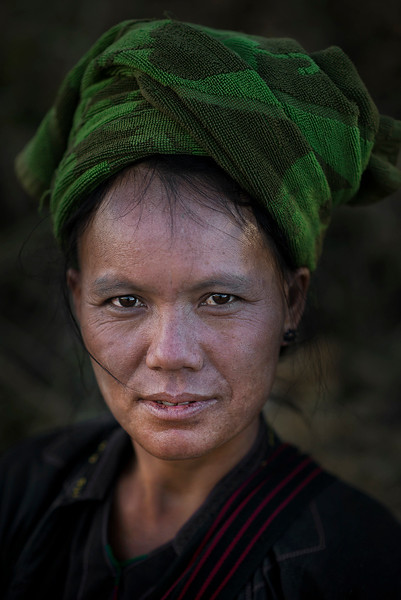 "The People of Myanmar are made up of a medley of tribes that mostly belong to southern Mongoloid stock. The Pa-O, also known as 'Taungthu' and 'Black Karen' form an ethnic group, comprising approximately 600.000.  The Pa-O form the second largest ethnic group in Shan State, after the Shans themselves and are classified as part of the ""Shan National Race"" by the government, although they are believed to be of Tibeto-Burman stock, and are ethno linguistically related to the Karen. The Pa-O settled in the Thaton region of present-day Myanmar about 1000 B.C. Historically, the Pa-O wore colorful clothing, until King Anawratha defeated the Mon King Makuta, who had established his reign in Thaton. The Pa-O were enslaved, and forced to wear indigo-dyed clothing, to signify their status. However, there are regional variations of clothing among the Pa-O.  Many have adopted Bamar clothing, while men may wear Shan baung-mi (long baggy pants), the women wear longyis, long sleeveless shirts and cropped long-sleeved jackets, but with a brightly colored turban.  The majority of Pa-O are Buddhists, but a written language was created by Christian missionaries. The Pa-O predominantly engage in agriculture, where their main cash crop is the than-nat leaf from sebesten trees, used for rolling Myanmar's traditional cigar, the cheroot"