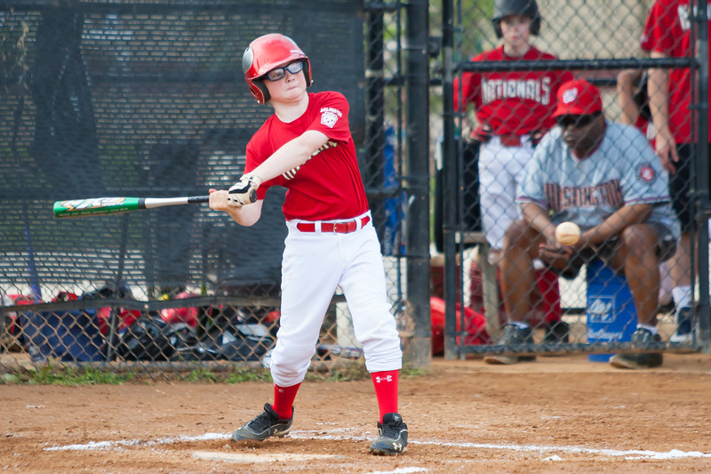 Christopher goes down swinging to end the 2nd inning with the game tied 1-1. The Nationals played an excellent defensive game, but came up just a little short against the Pirates who scored the go-ahead run in the top of the 6th inning, winning 2-1. They are now 4-3 for the season. 2012 Arlington Little League Baseball, Majors Division. Nationals vs Pirates (01 May 2012) (Image taken by Patrick R. Kane on 01 May 2012 with Canon EOS-1D Mark III at ISO 800, f2.8, 1/1600 sec and 200mm)