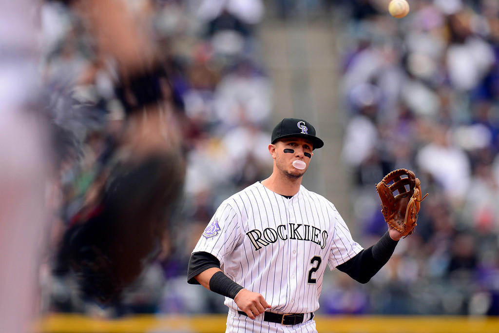 . DENVER, CO - MAY 5: Troy Tulowitzki (2) of the Colorado Rockies blows a bubble as the infield defense throws the ball around the horn during the Rockies 8-3 loss.   (Photo by AAron Ontiveroz/The Denver Post)