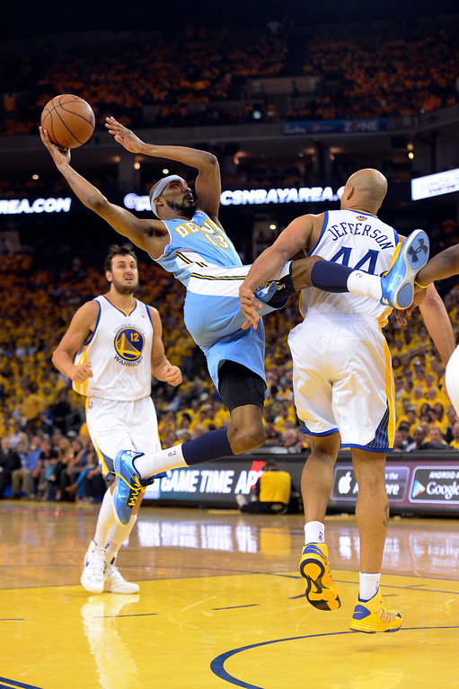 . OAKLAND, CA. - APRIL 26: Corey Brewer (13) of the Denver Nuggets gets tangled up by Richard Jefferson (44) of the Golden State Warriors as he takes a shot in the second quarter in game 3 of the first round of the NBA Playoffs April 26, 2013 at Oracle Arena.  (Photo By John Leyba/The Denver Post)