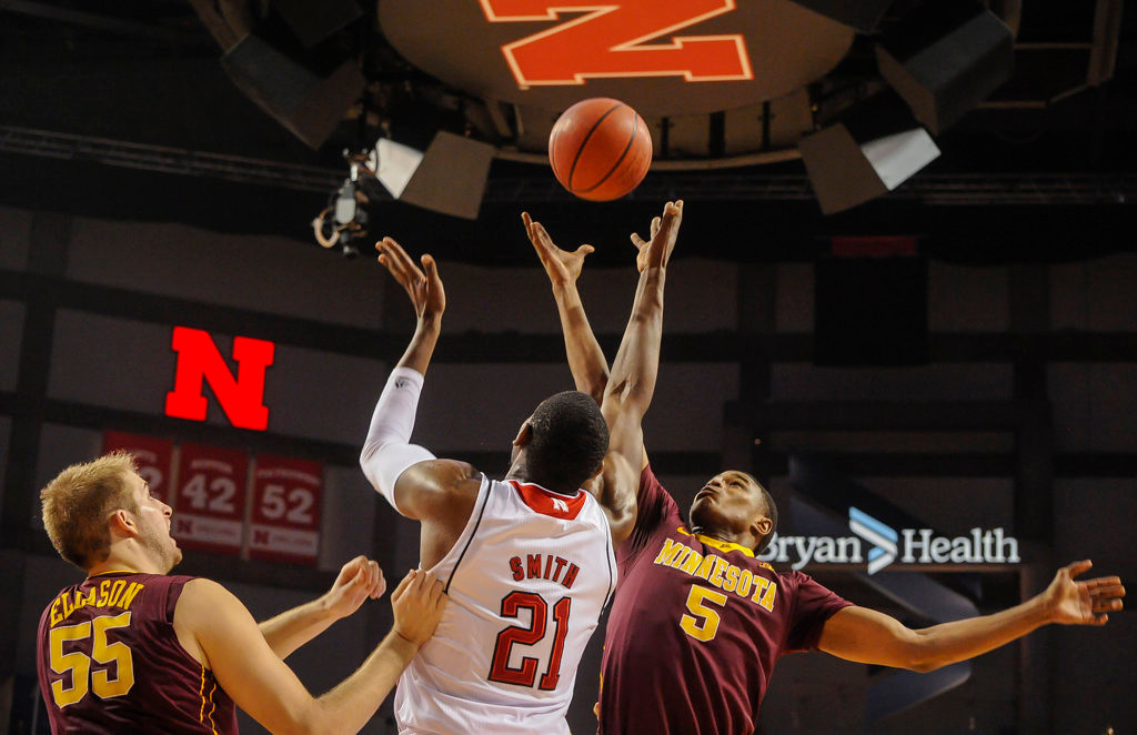 . Minnesota Golden Gophers guard Daquein McNeil (5) and Minnesota Golden Gophers center Elliott Eliason (55) go for a rebound against Nebraska Cornhuskers forward Leslee Smith (21). (AP Photo/Dave Weaver)