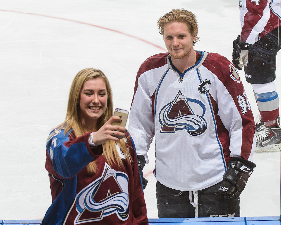 . Gabriel Landeskog #92 of the Colorado Avalanche takes a selfie with a fan during warm-ups prior to an NHL game against the Edmonton Oilers at Rexall Place on April 8, 2014 in Edmonton, Alberta, Canada. (Photo by Derek Leung/Getty Images)