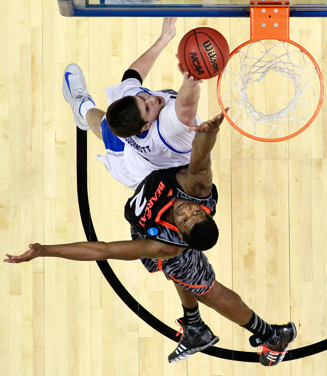. Creighton\'s Doug McDermott, top, tries to get a shot past Cincinnati\'s Titus Rubles during the second half of a second-round game of the NCAA college basketball tournament, Friday, March 22, 2013, in Philadelphia. (AP Photo/Matt Slocum)