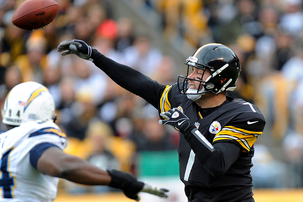 Description of . Pittsburgh Steelers quarterback Ben Roethlisberger (7) tpasses as he is pressured by San Diego Chargers outside linebacker Melvin Ingram (54) in the second quarter of an NFL football game on Sunday, Dec. 9, 2012, in Pittsburgh. (AP Photo/Don Wright)