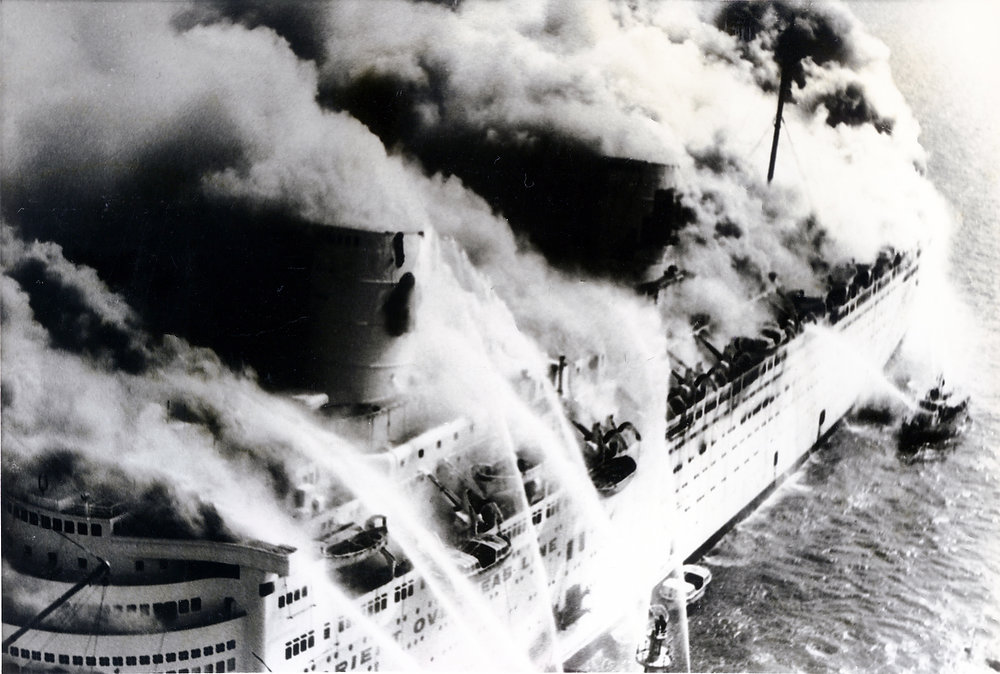 Description of . Fireboats spray water on the burning luxury liner Queen Elizabeth, now renamed Seawise University in Hong Kong harbour on Sunday, Jan. 11, 1972. (AP Photo)