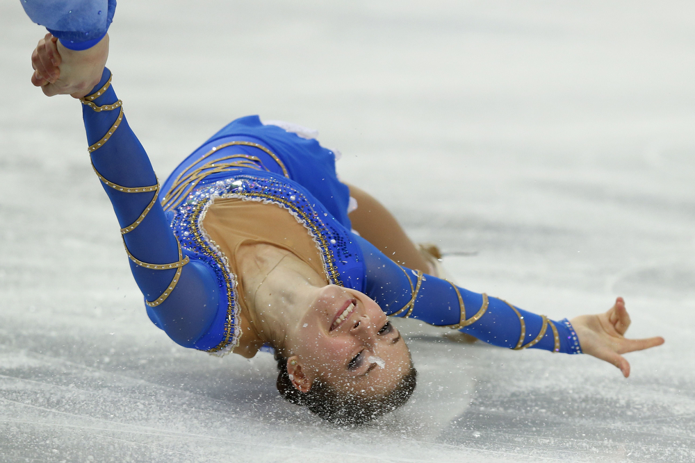 . Israel\'s Evgeni Krasnopolski and Israel\'s Andrea Davidovich perform their Figure Skating Pairs Free Program at the Iceberg Skating Palace during the Sochi Winter Olympics on February 12, 2014. (ADRIAN DENNIS/AFP/Getty Images)